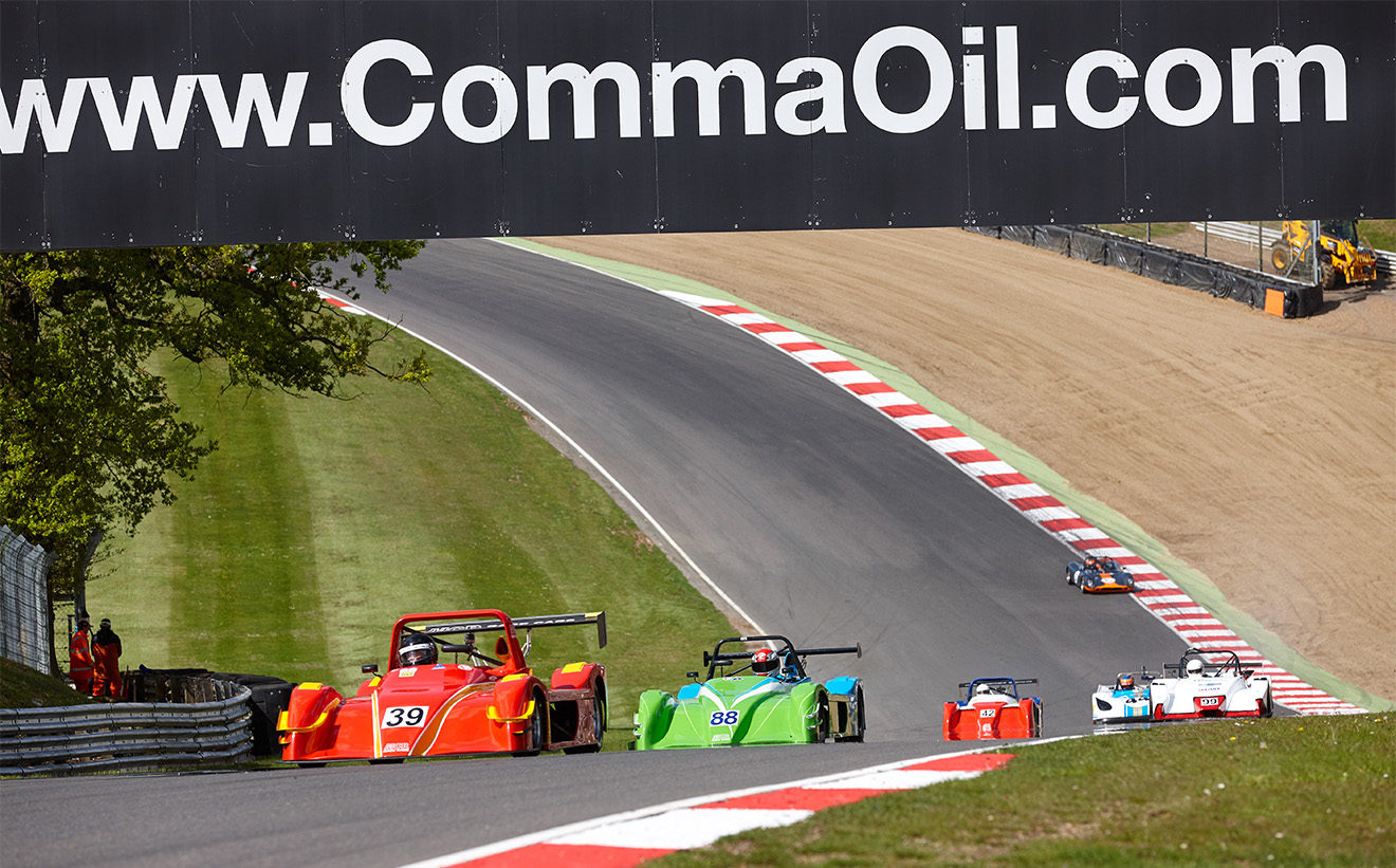 Racing at Brands Hatch GP circuit with MCR Race Cars